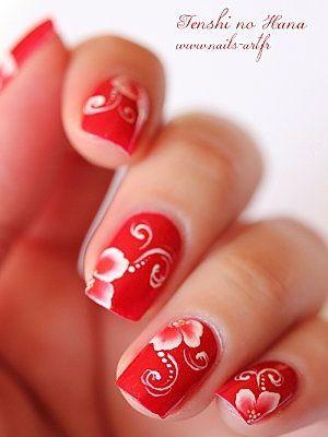 червоні нігті з білим візерунком